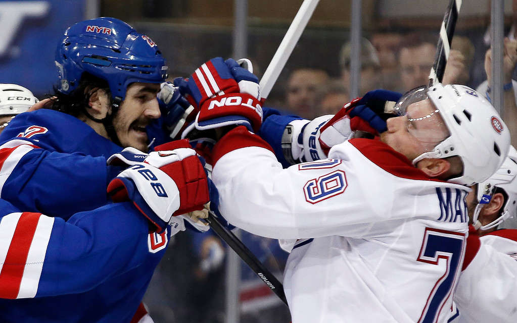 . New York Rangers center Brian Boyle and Montreal Canadiens defenseman Andrei Markov (79), of Russia, fight during the second period of Game 4 of the NHL hockey Stanley Cup playoffs Eastern Conference finals, Sunday, May 25, 2014, in New York. (AP Photo/Kathy Willens)