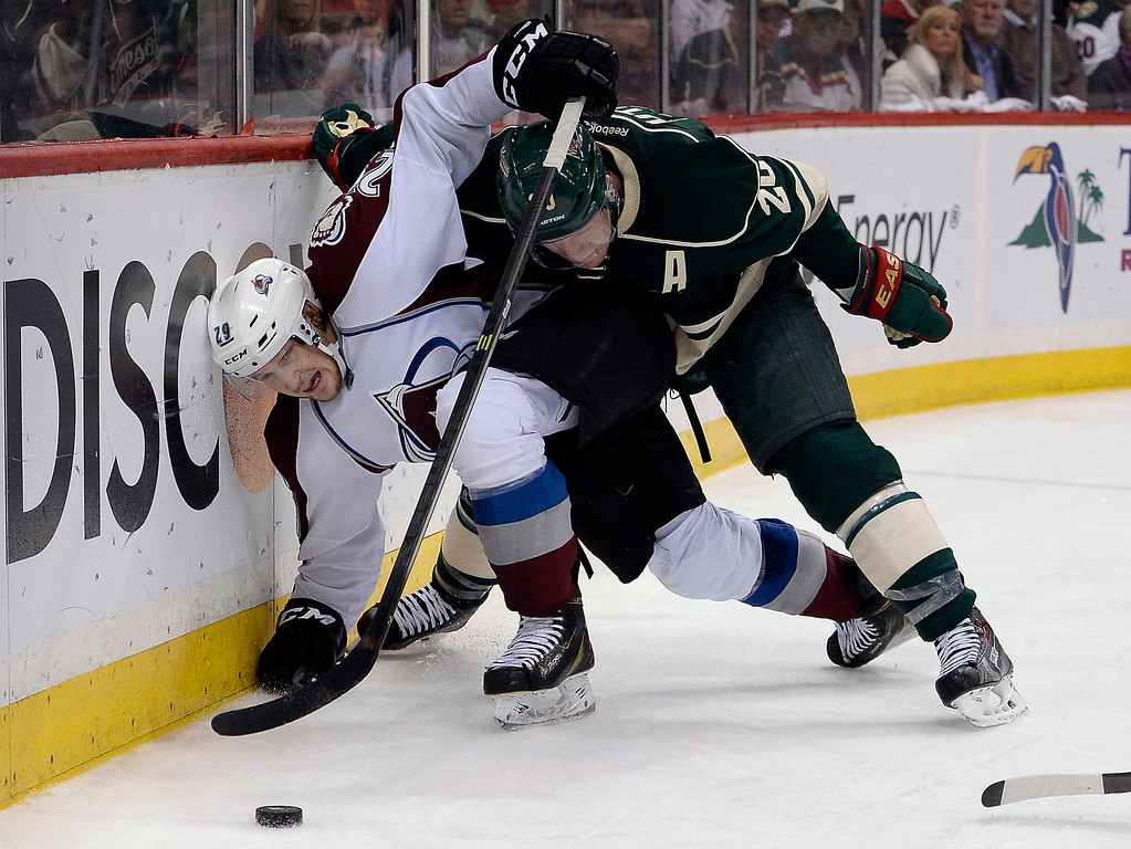 . Minnesota Wild defenseman Ryan Suter (20) pins Colorado Avalanche center Nathan MacKinnon (29) up against the boards during the third period April 28, 2014 in Game 6 of the Stanley Cup Playoffs at Xcel Energy Center.  (Photo by John Leyba/The Denver Post)
