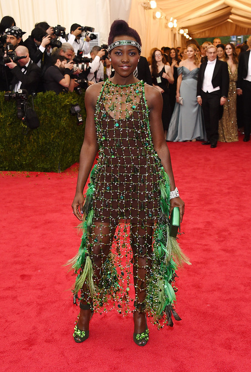 """. Lupita Nyong\'o attends the \""""Charles James: Beyond Fashion\"""" Costume Institute Gala at the Metropolitan Museum of Art on May 5, 2014 in New York City.  (Photo by Larry Busacca/Getty Images)"""