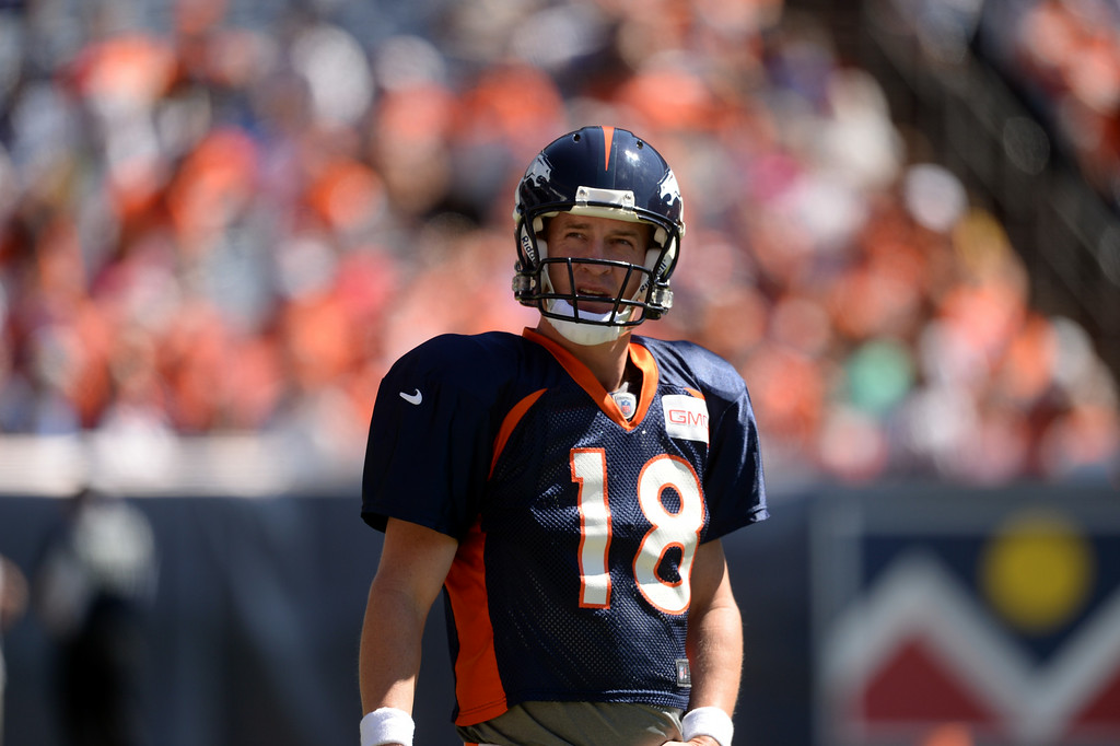 . Peyton Manning of Denver Broncos (18) is warming up for the Broncos scrimmage at Sports Authority Field at Mile High. Denver, Colorado. August 02. 2014. (Photo by Hyoung Chang/The Denver Post)