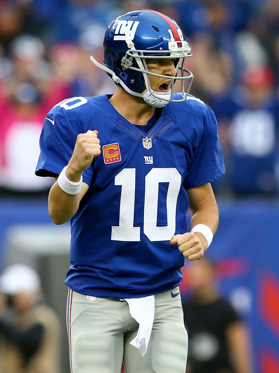 . Eli Manning #10 of the New York Giants celebrates a touchdown in the first quarter against the Philadelphia Eagles at MetLife Stadium on October 6, 2013 in East Rutherford, New Jersey.  (Photo by Elsa/Getty Images)