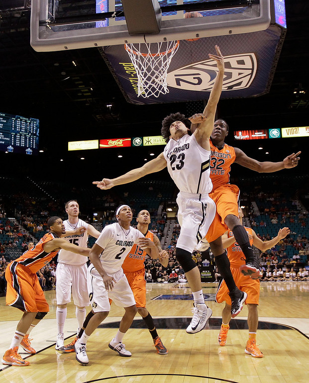 . Colorado\'s Sabatino Chen (23) shoots against Oregon State\'s Jarmal Reid in the first half during a Pac-12 tournament NCAA college basketball game on Wednesday, March 13, 2013, in Las Vegas. Colorado won 74-68. (AP Photo/Julie Jacobson)