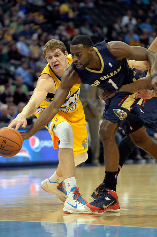 . Denver Nuggets center Timofey Mozgov (25) and New Orleans Pelicans forward Tyreke Evans (1) goes after a loose ball during the first quarter April 2, 2014 at the Pepsi Center in Denver. (Photo by John Leyba/The Denver Post)