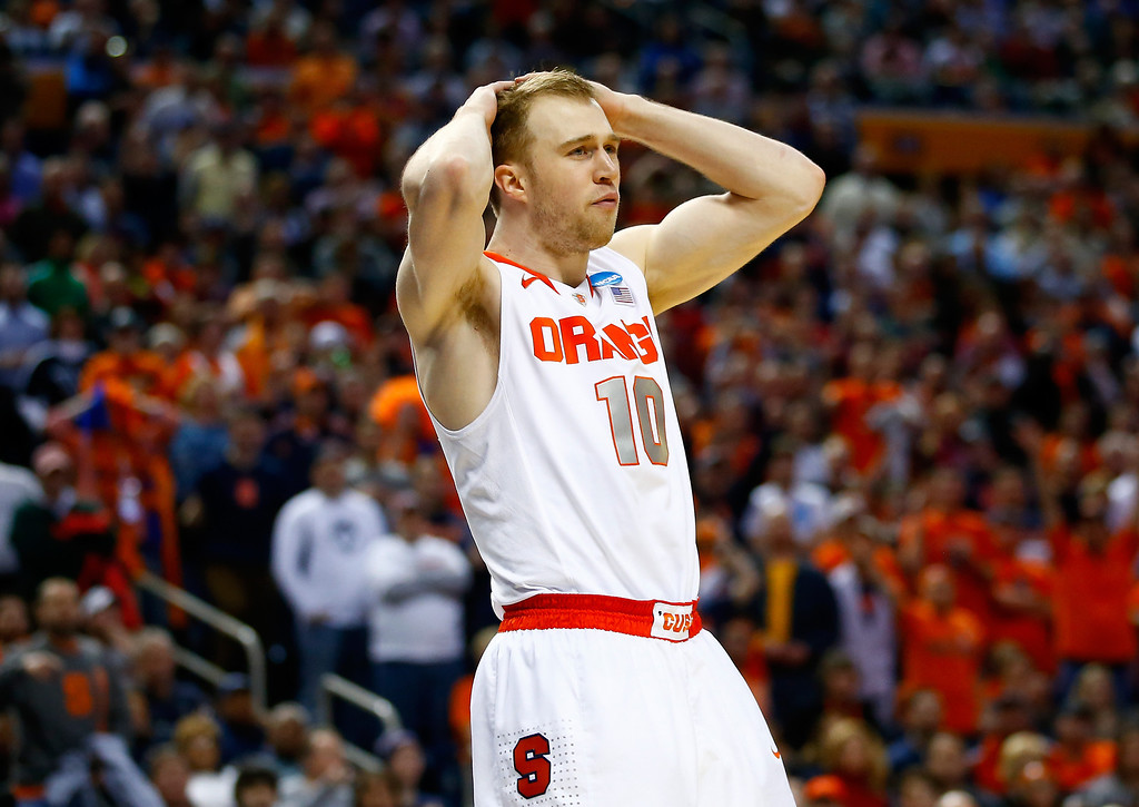 . BUFFALO, NY - MARCH 22: Trevor Cooney #10 of the Syracuse Orange reacts against the Dayton Flyers during the third round of the 2014 NCAA Men\'s Basketball Tournament at the First Niagara Center on March 22, 2014 in Buffalo, New York.  (Photo by Jared Wickerham/Getty Images)