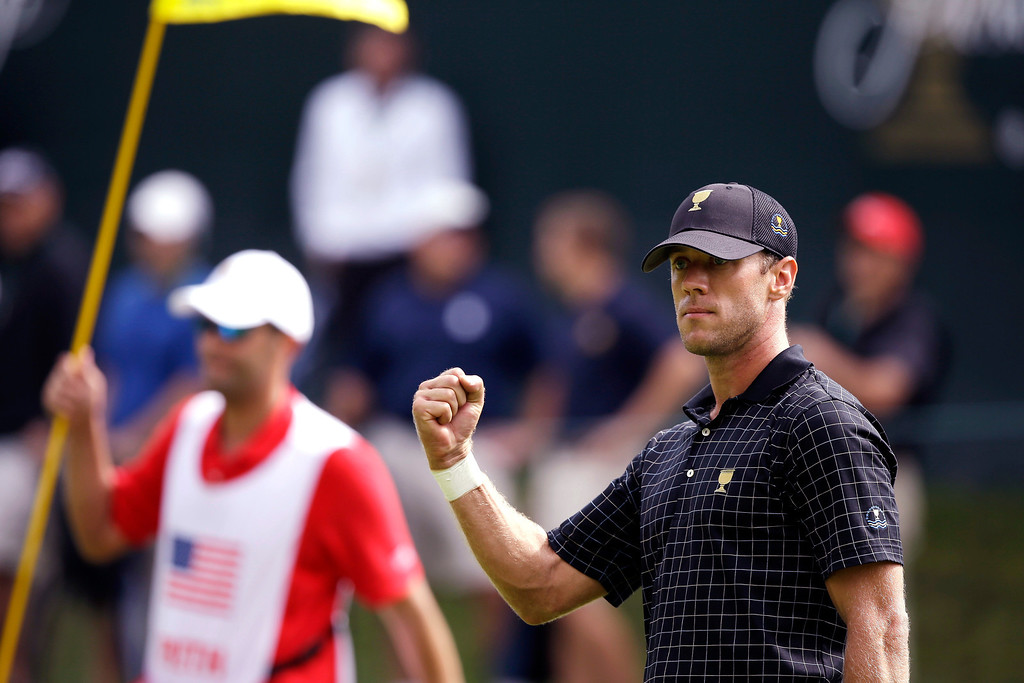 . International team player Graham DeLaet, of Canada, reacts to a putt on the 15th green during the single matches at the Presidents Cup golf tournament at Muirfield Village Golf Club Sunday, Oct. 6, 2013, in Dublin, Ohio. (AP Photo/Darron Cummings)