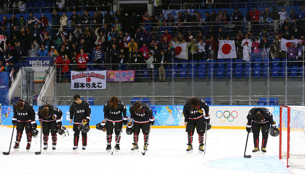 . SOCHI, RUSSIA - FEBRUARY 09:  Members of the Japan ice hockey team bow after the Women\'s Ice Hockey Preliminary Round Group B Game on day two of the Sochi 2014 Winter Olympics at Shayba Arena on February 9, 2014 in Sochi, Russia.  (Photo by Martin Rose/Getty Images)