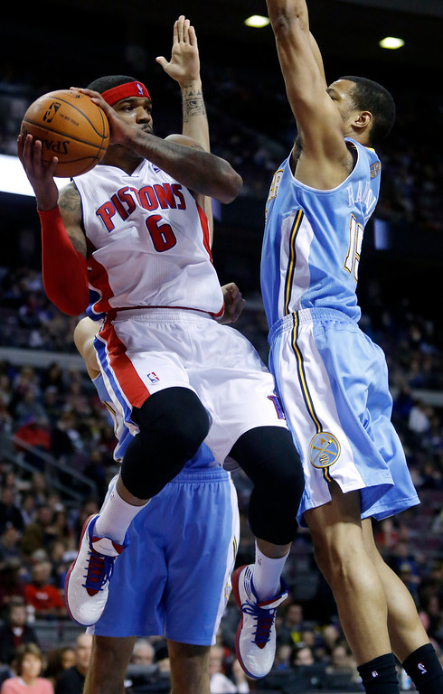. Detroit Pistons forward Josh Smith (6) looks to pass the ball against Denver Nuggets forward Anthony Randolph (15) during the second half of an NBA basketball game on Saturday, Feb. 8, 2014, in Auburn Hills, Mich. The Pistons won 126-109. (AP Photo/Duane Burleson)