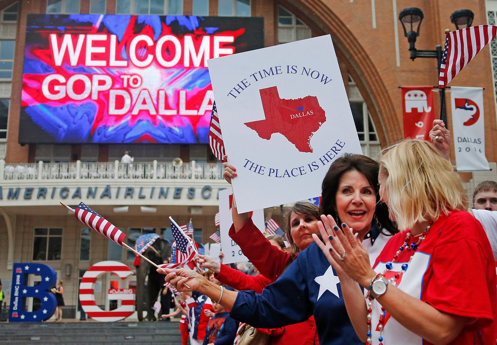 . Republican supporters cheer the arrival of the Republican National Committee site selection committee as they visit the American Airlines Center, as they are courted by the city for the 2016 national convention, on Thursday, June 12, 2014.  (Louis DeLuca/Dallas Morning News)