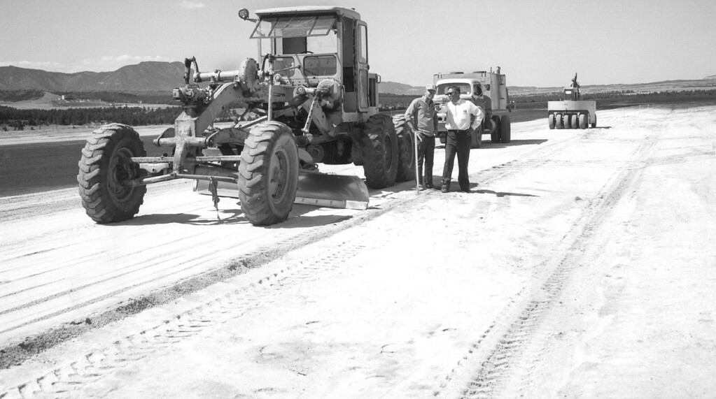 ". Workmen Survey $76,700 Runway Paving Project At Air Force Academy, here, near completion It falls short of $21 million ""dream\"" of 11,000-foot instrumented runway with hangars and support facilities. 1967. The Denver Post Library Archive"