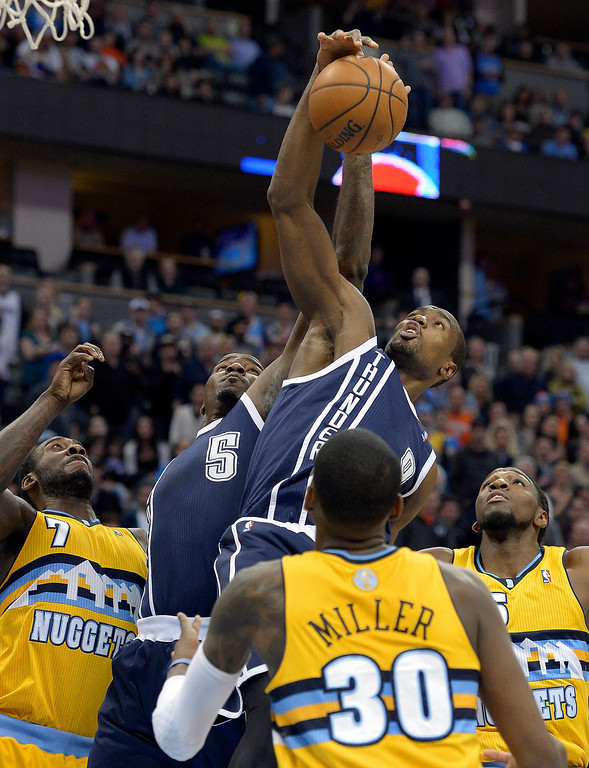 . Oklahoma City Thunder power forward Serge Ibaka (9) hauls down a rebound during the first quarter against the Denver Nuggets  January 9, 2014 at Pepsi Center. (Photo by John Leyba/The Denver Post)