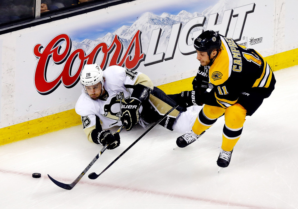. Brandon Sutter #16 of the Pittsburgh Penguins and Gregory Campbell #11 of the Boston Bruins fight for a loose puck during Game Three of the Eastern Conference Final of the 2013 NHL Stanley Cup Playoffs at the TD Garden on June 5, 2013 in Boston, Massachusetts.  (Photo by Jared Wickerham/Getty Images)