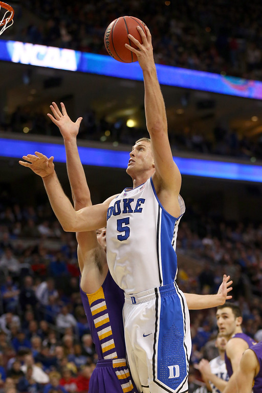 . Mason Plumlee #5 of the Duke Blue Devils shoots the ball in the lane against the Albany Great Danes in the second half during the second round of the 2013 NCAA Men\'s Basketball Tournament on March 22, 2013 at Wells Fargo Center in Philadelphia, Pennsylvania.  (Photo by Elsa/Getty Images)