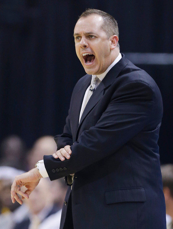 . Indiana Pacers coach Frank Vogel reacts to a play during the first half of Game 5 of the NBA basketball Eastern Conference finals against the Miami Heat, in Indianapolis, Wednesday, May 28, 2014. (AP Photo/Michael Conroy)