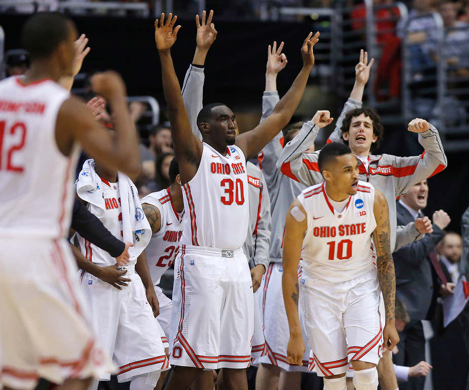 . Ohio State players celebrate a 3-point shot against Arizona by LaQuinton Ross (10) during the second half of a West Regional semifinal in the NCAA men\'s college basketball tournament, Thursday, March 28, 2013, in Los Angeles. (AP Photo/Jae C. Hong)