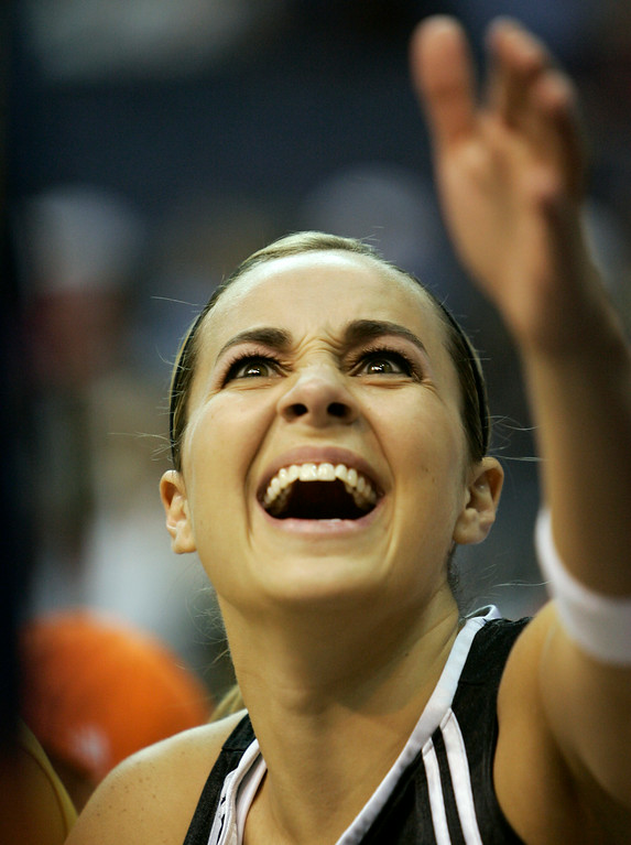 """. Becky Hammon, of the San Antonio Silver Stars smiles as she is congratulated after winning the \""""Dribble, Dish, and Swish\"""" skills challenge during the WNBA all-star game on Sunday, July 15, 2007 in Washington.   (AP Photo/Evan Vucci)"""