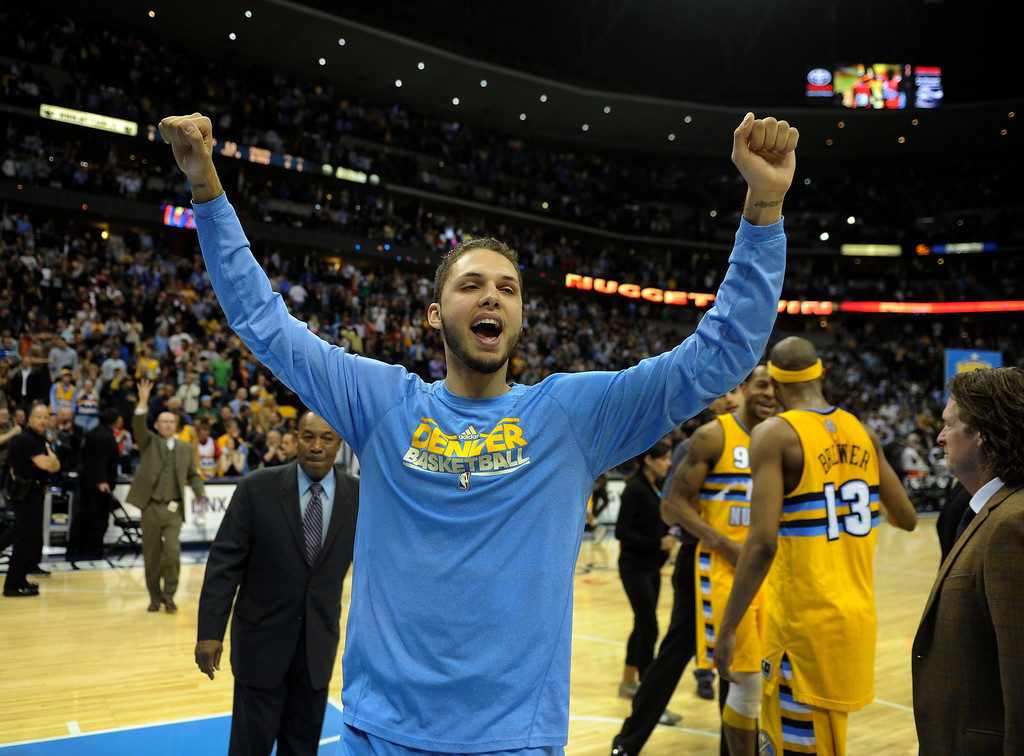 . DENVER, CO. - MARCH 21: Evan Fournier (94) of the Denver Nuggets celebrated the win Thursday night. The Denver Nuggets defeated the Philadelphia 76ers 101-100 Thursday night, March 21, 2013 at the Pepsi Center. The Nuggets are on a 14-game record winning streak that is a team record. (Photo By Karl Gehring/The Denver Post)
