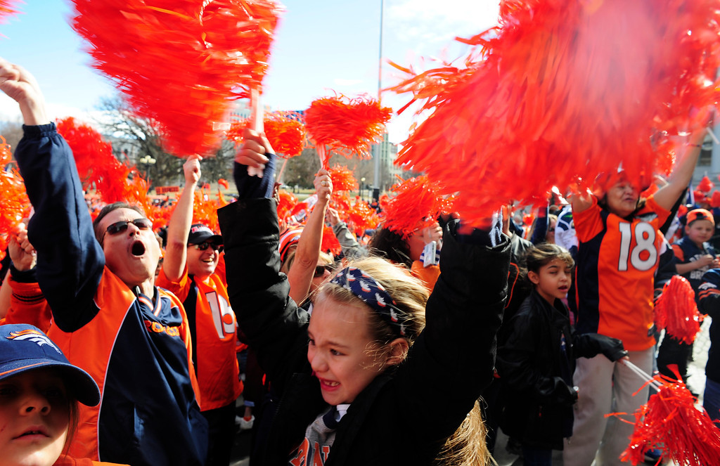 . Jaylene Bruce, 8, (center) waves pompoms in a crowd of Broncos supporters during a rally to send off the team, at the City and County Building in Denver, Colorado, Sunday, January 26, 2014. The noon rally brought out scores of supporters and included an appearance by Governor John Hickenlooper and Denver Mayor Michael Hancock.  (Photo By Brenden Neville / Special to The Denver Post)