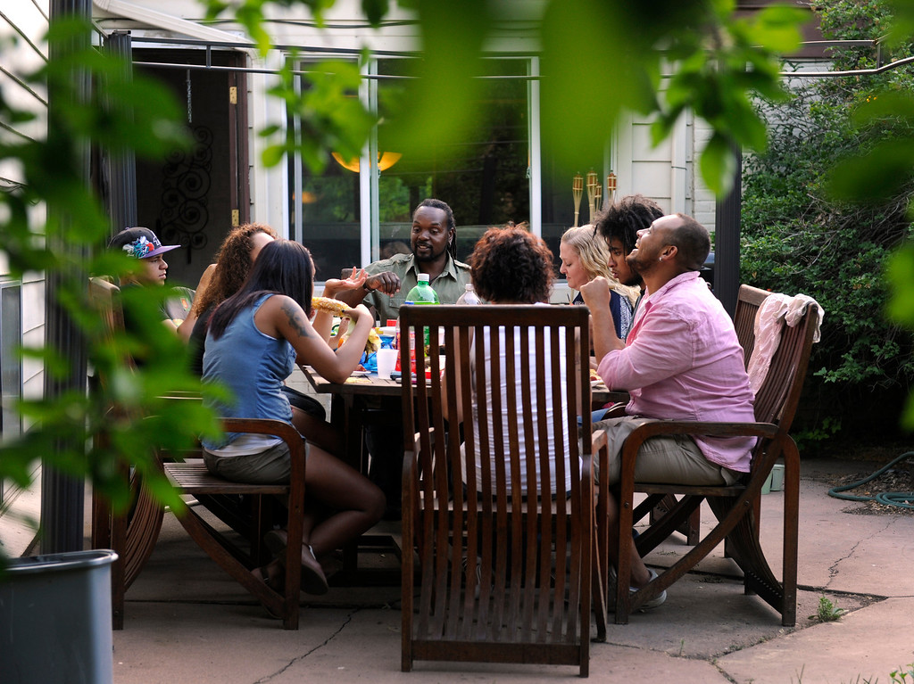 . DENVER, CO - JUNE 25: Laura and Keenon Stillman are joined by their children for a summer meal outside in the family backyard. (Photo By Kathryn Scott Osler/The Denver Post)