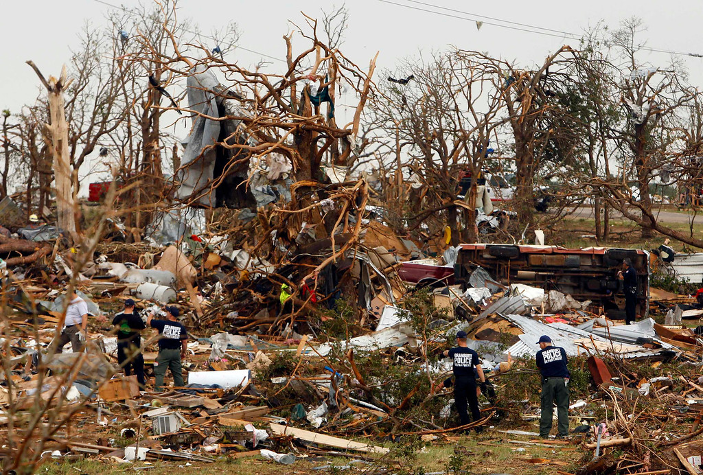. Rescue workers comb through debris May 16 after tornados swept through the town of Granbury, Texas late May 15, 2013.  REUTERS/Richard Rodriguez