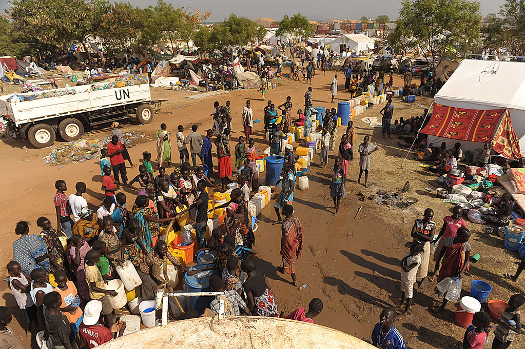 . South Sudanese women queue for water being distributed from a UN resevoir at the United Nations Mission in South Sudan (UNMISS) compound in Juba on December 21, 2013 where tension remains high fueling an exodus of both local and foreign residents from the south Sudanese capital. Brutal fighting in South Sudan has reopened deep-rooted ethnic divisions, forcing tens of thousands of terrified residents to seek shelter at UN bases or flee in fear of attacks. United Nations peacekeepers are currently sheltering over 35,000 civilians in various bases across the country, many belonging to the minority ethnic group in their respective areas.   TONY KARUMBA/AFP/Getty Images