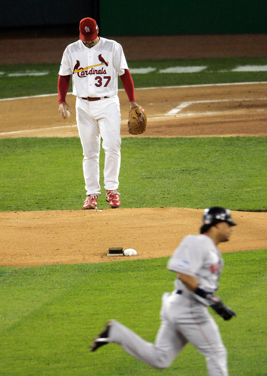 . St. Louis Cardinals pitcher Jeff Suppan (37) hangs his head after giving up a first inning homer to Boston Red Sox\'s Manny Ramirez, right, in Game 3 of the World Series Tuesday, Oct. 26, 2004, in St. Louis. (AP Photo/Sue Ogrocki)