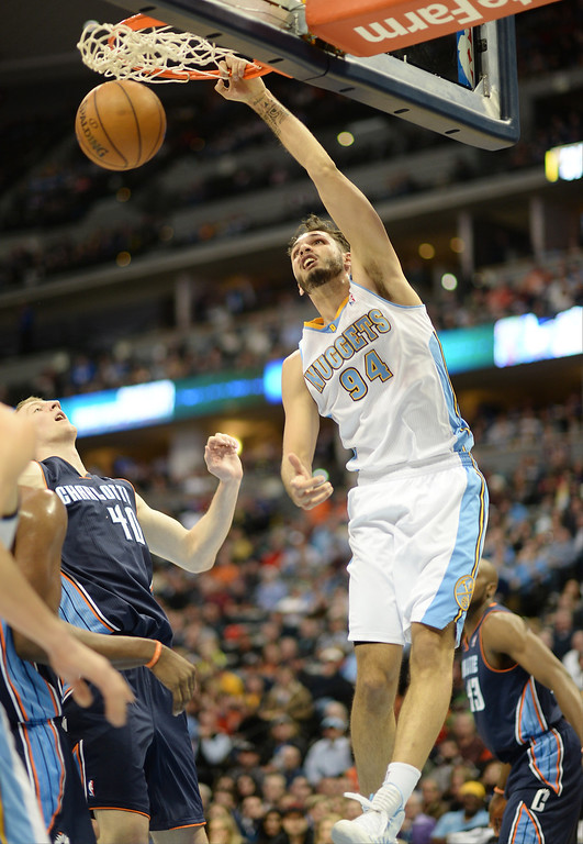 . Evan Fournier of the Denver Nuggets (94) dunks in the second half of the game against the Charlotte Bobcats. (Photo by Hyoung Chang/The Denver Post)