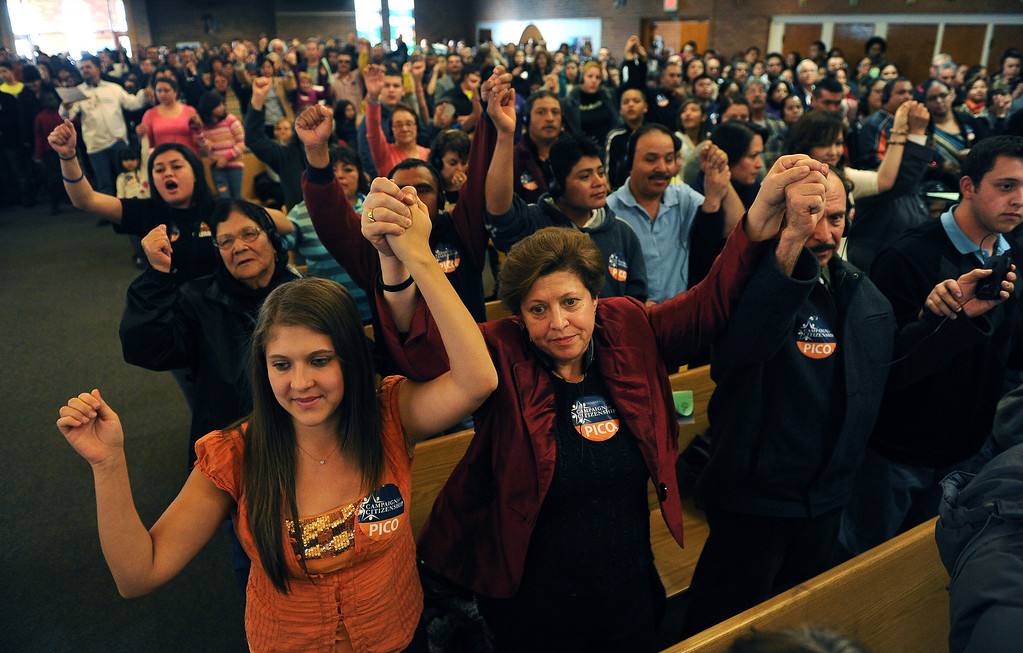 . AURORA, CO- FEBRUARY 9: Members of the audience hold up their hands in support during the public meeting that was filled to capacity inside the church.  TOGETHER COLORADO held a public meeting  to talk about the United States immigration policies at St. Therese Catholic Church, 1243 Kingston Street in Aurora, Co  on February 9th, 2013.   Colorado State Senator Michael Bennet, and Colorado Representatives Mike Coffman and Jared Polis attended and spoke at the meeting.  The organization wanted to tell the state\'s representatives why they want a road map to citizenship for 11 million aspiring Americans.  More than 800 faith and community leaders packed the small church in Aurora. (Photo By Helen H. Richardson/ The Denver Post)