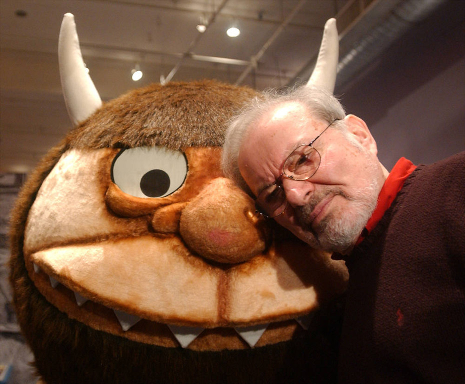 ". Standing with a character from his book ""Where the Wild Things Are,\"" author and illustrator Maurice Sendak. Photo by Spencer Platt/Getty Images)"