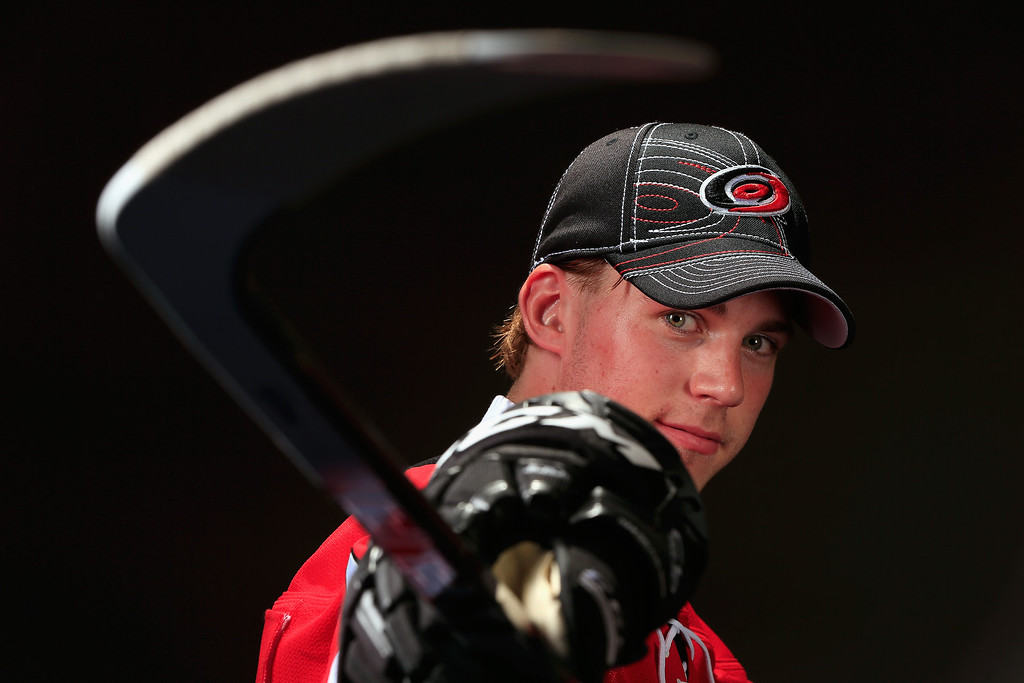 . Elias Lindholm poses for a portrait after being selected number five over all in the first round by the Carolina Hurricanes during the 2013 NHL Draft at the Prudential Center on June 30, 2013 in Newark, New Jersey.  (Photo by Jamie Squire/Getty Images)