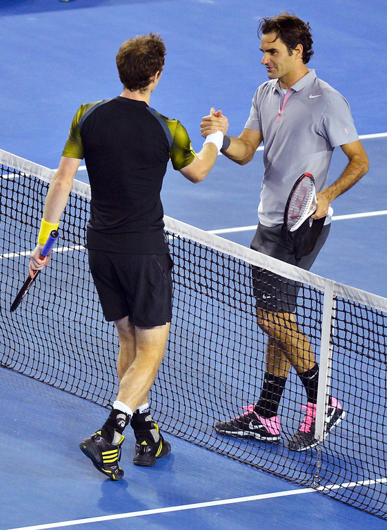 . Andy Murray of Britain (L) shakes hands with Roger Federer of Switzerland after defeating him in their men\'s singles semi-final match at the Australian Open tennis tournament in Melbourne, January 25, 2013.  REUTERS/Toby Melville