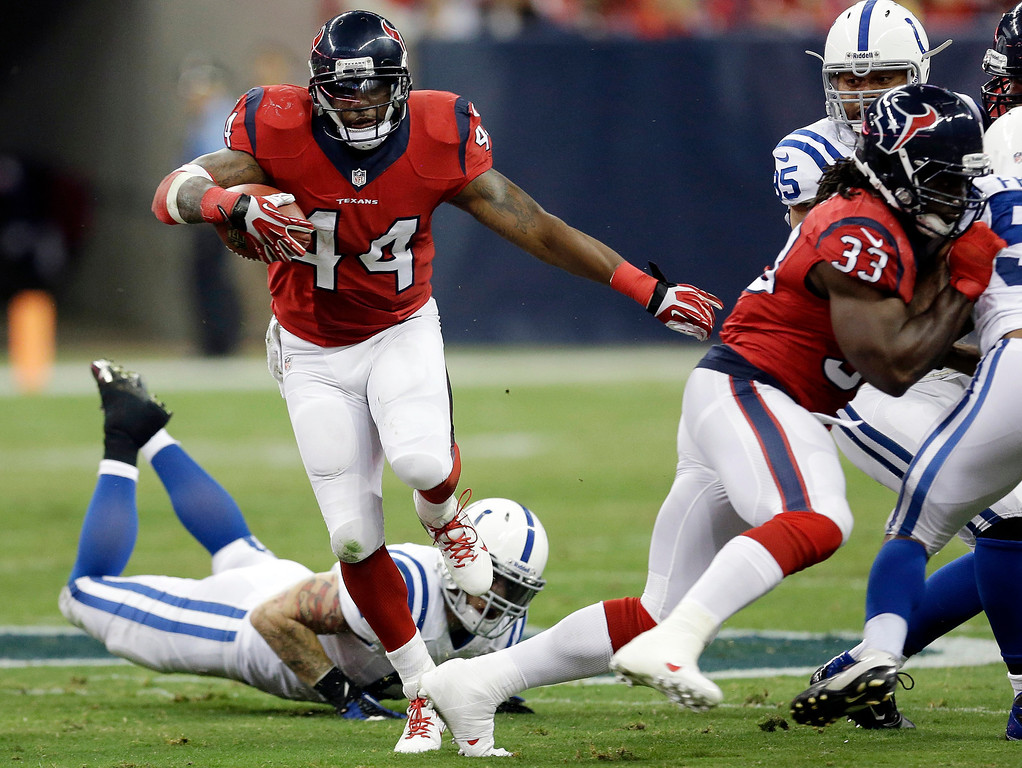 . Houston Texans\' Ben Tate (44) runs against the Indianapolis Colts during the first quarter of an NFL football game Sunday, Nov. 3, 2013, in Houston. (AP Photo/David J. Phillip)
