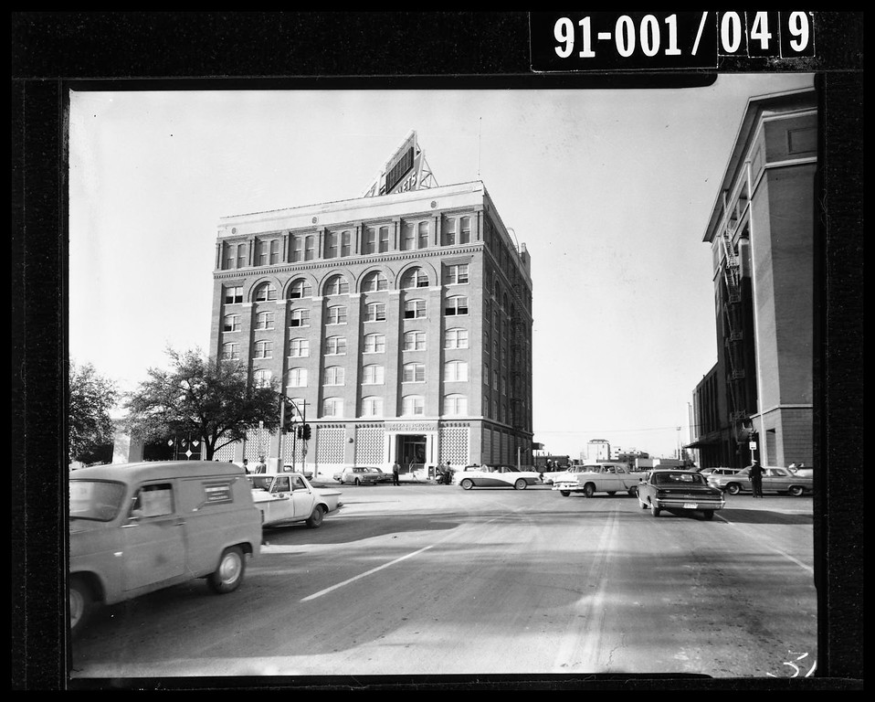 . The Texas School Book Depository building, which overlooks Dealey Plaza, quickly became the focus of law enforcement as they began the manhunt for  Kennedy\'s assassin. Dallas Police Department/Dallas Municipal Archives