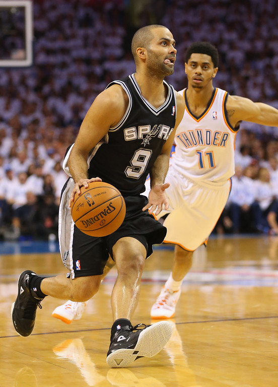 . OKLAHOMA CITY, OK - MAY 31:  Tony Parker #9 of the San Antonio Spurs drives with the ball against Jeremy Lamb #11 of the Oklahoma City Thunder in the first half during Game Six of the Western Conference Finals of the 2014 NBA Playoffs at Chesapeake Energy Arena on May 31, 2014 in Oklahoma City, Oklahoma. (Photo by Ronald Martinez/Getty Images)