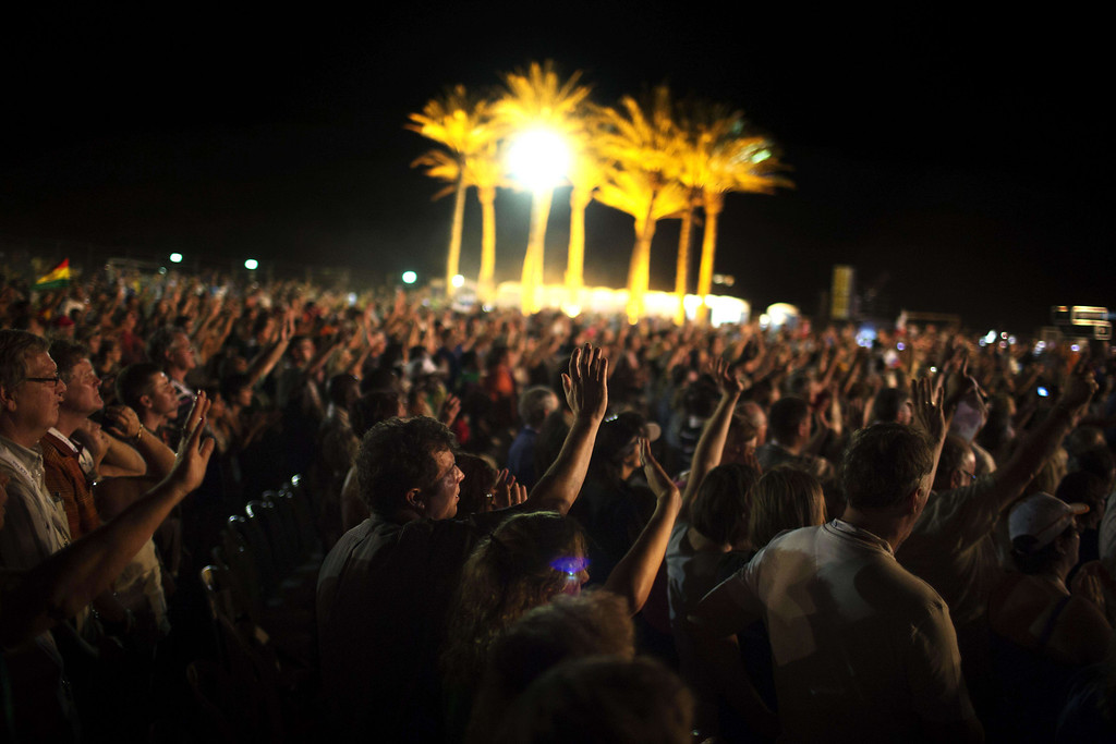 . Thousands of evangelical Christian pilgrims pray during a prayer gathering on the Dead Sea shore in Ein Gedi on September 20, 2013 in the Judean Desert, during their the annual visit to Israel to mark the Jewish holiday of Sukkot (Tabernacles) and to express solidarity with Israel. Some five thousands of Christian pilgrims from around the world arrived for a long week visit to Israel, in an annual show of solidarity with the Jewish state. MENAHEM KAHANA/AFP/Getty Images