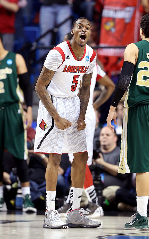 . LEXINGTON, KY - MARCH 23: Kevin Ware #5 of the Louisville Cardinals celebrates after a play against the Colorado State Rams in the first half during the third round of the 2013 NCAA Men\'s Basketball Tournament at Rupp Arena on March 23, 2013 in Lexington, Kentucky.  (Photo by Andy Lyons/Getty Images)