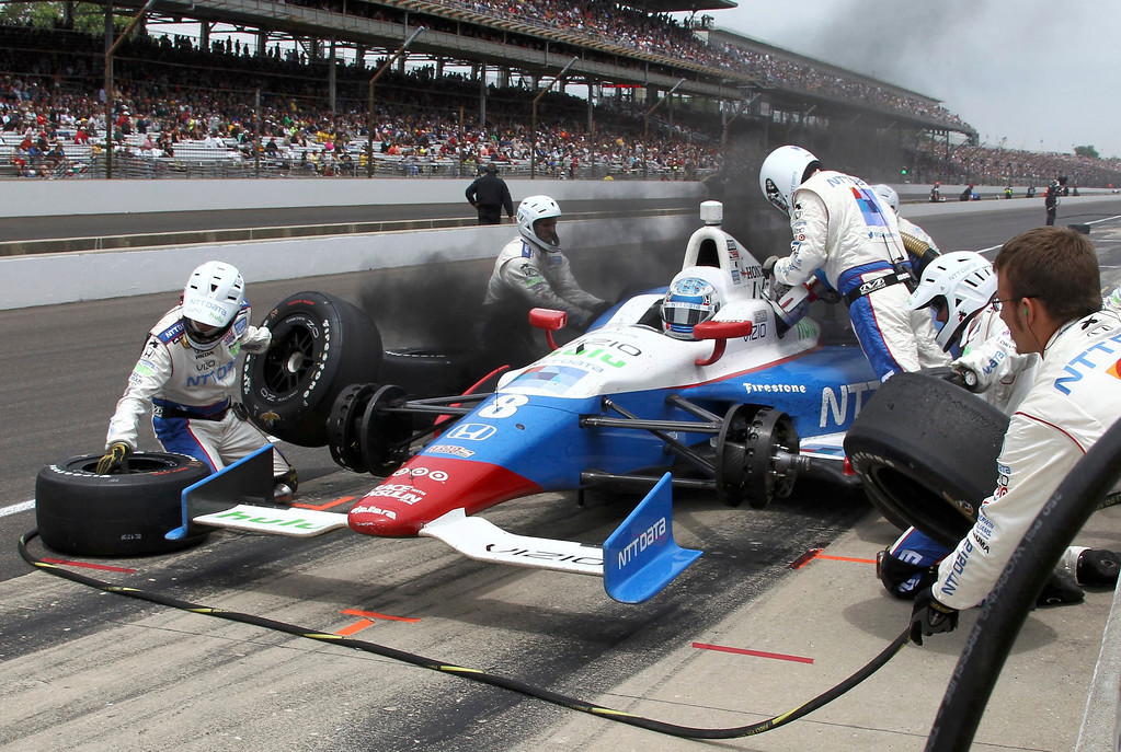 . Smoke wafts from the car of Chip Ganassi Racing driver Ryan Briscoe of Australia at a pit stop during the 97th running of the Indianapolis 500 at the Indianapolis Motor Speedway in Indianapolis, Indiana, May 26, 2013. REUTERS/Kirk Debrunner