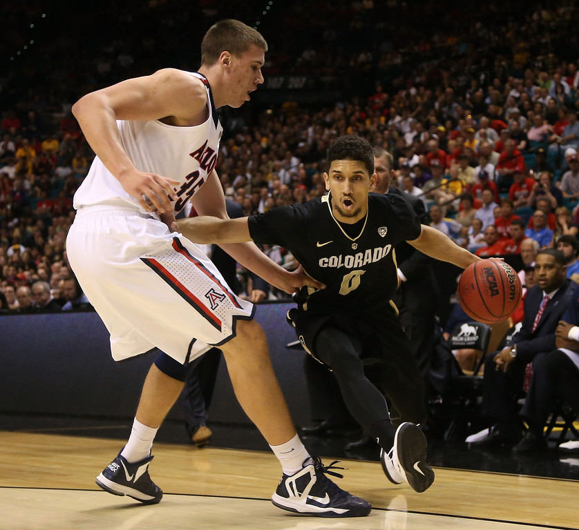 . Askia Booker #0 of the Colorado Buffaloes drives on Kaleb Tarczewski #35 of the Arizona Wildcats in the first half during the quarterfinals of the Pac-12 tournament at the MGM Grand Garden Arena on March 14, 2013 in Las Vegas, Nevada.  (Photo by Jeff Gross/Getty Images)