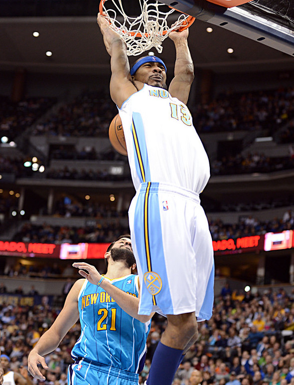 . DENVER, CO. - FEBRUARY 01: Corey Brewer of Denver Nuggets #13 dunks over Greivis Vasquez #21 of New Orleans Hornets during the 1st half of the game on February 1, 2013 at the Pepsi Center in Denver, Colorado. (Photo By Hyoung Chang/The Denver Post)