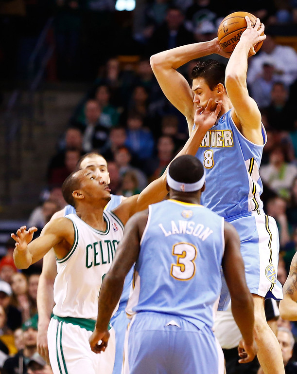 . BOSTON, MA - FEBRUARY 10: Danilo Gallinari #8 of the Denver Nuggets is fouled by Avery Bradley #0 of the Boston Celtics during the game on February 10, 2013 at TD Garden in Boston, Massachusetts.  (Photo by Jared Wickerham/Getty Images)