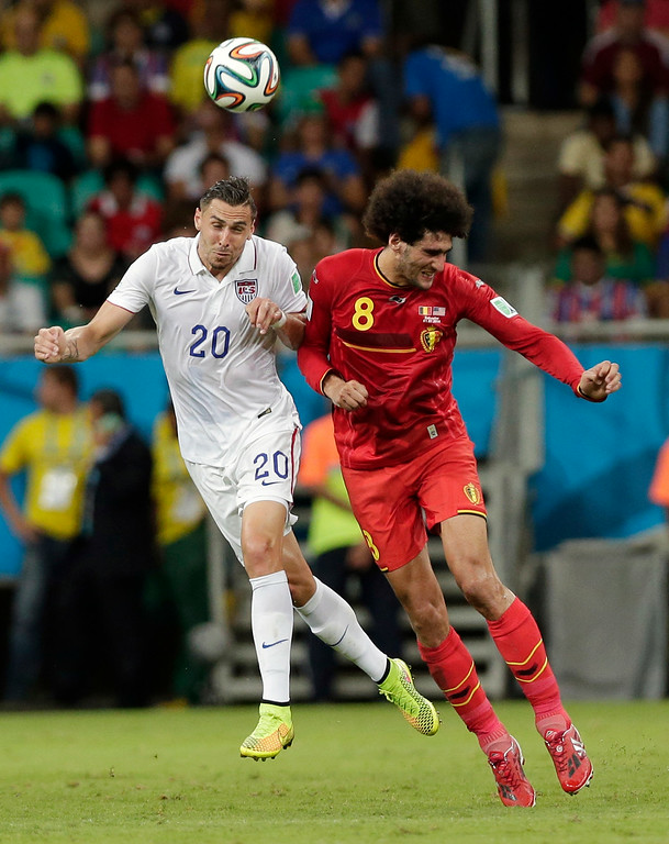 . Belgium\'s Marouane Fellaini heads the ball against United States\' Geoff Cameron during the World Cup round of 16 soccer match between Belgium and the USA at the Arena Fonte Nova in Salvador, Brazil, Tuesday, July 1, 2014. (AP Photo/Marcio Jose Sanchez)