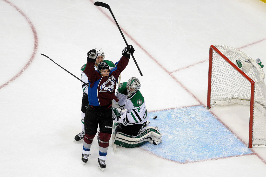 . Colorado Avalanche center Paul Stastny (26) celebrates a goal by teammate left wing Gabriel Landeskog (92) as Dallas Stars goalie Kari Lehtonen (32) and defenseman Brenden Dillon (4) react during the second period. (Photo by AAron Ontiveroz/The Denver Post)