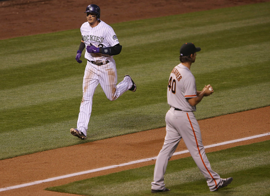 . Troy Tulowitzki #2 of the Colorado Rockies heads for home on his solo home run as starting pitcher Madison Bumgarner #40 of the San Francisco Giants heads to the mound as the Rockies take a 1-0 lead in the fifth inning at Coors Field on April 22, 2014 in Denver, Colorado.  (Photo by Doug Pensinger/Getty Images)