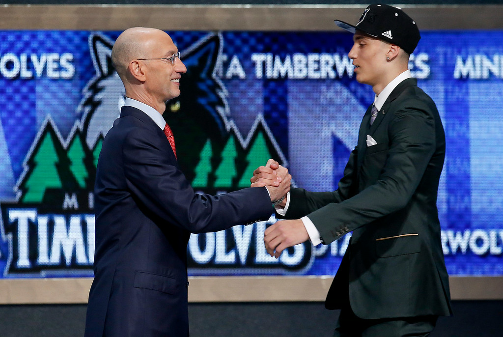 . UCLA\'s Zach LaVine, right, is greeted by NBA commissioner Adam Silver after being selected 13th overall by the Minnesota Timberwolves during the 2014 NBA draft, Thursday, June 26, 2014, in New York.(AP Photo/Kathy Willens)