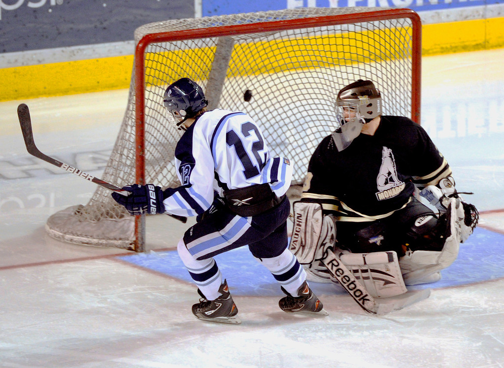 . DENVER, CO. - FEBRUARY 28: Mustangs forward Victor Lombardi (12) lifted a shot past Coyotes goaltender Ian Oden on a breakaway in the third period. Ralston Valley High School beat Monarch 5-1 Friday night, March 1, 2013 to win the Colorado hockey championship at Magness Arena in Denver. (Photo By Karl Gehring/The Denver Post)