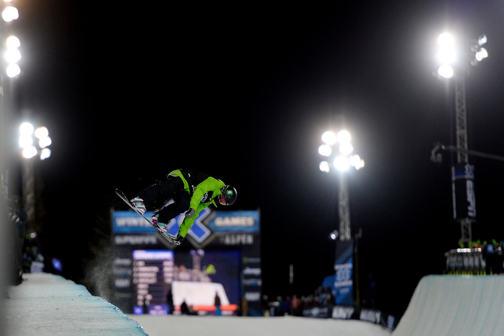 . Elena Hight makes a grab during the women\'s snowboard halfpipe. X Games Aspen at Buttermilk on Friday, January 25, 2014. (Photo by AAron Ontiveroz/The Denver Post)
