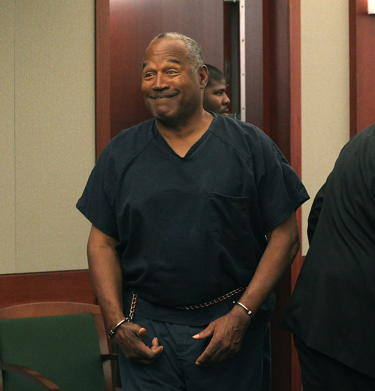 . O.J. Simpson appears at Clark County Regional Justice Center in Las Vegas, Monday, May 13, 2013. Simpson, who is currently serving a nine-to-33-year sentence in state prison as a result of his October 2008 conviction on armed robbery and kidnapping charges, is seeking a new trial, claiming that trial lawyer Yale Galanter had conflicted interests and shouldn\'t have handled Simpson\'s armed case. (AP Photo/Las Vegas Review-Journal, Jeff Scheid, Pool)