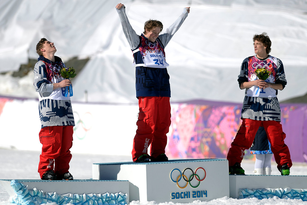 . U.S.A. medalists from left to right, Gus Kenworthy (silver), Joss Christensen (gold) and Nick Goepper (bronze) celebrate on the podium after the men\'s ski slopestyle final at the Rosa Khutor Extreme Park. Sochi 2014 Winter Olympics on Thursday, February 13, 2014. (Photo by AAron Ontiveroz/The Denver Post)