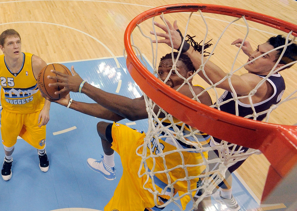 . Denver Nuggets power forward Kenneth Faried (35) goes for a basket on Oklahoma City Thunder center Steven Adams (12) during the first quarter January 9, 2014 at Pepsi Center. (Photo by John Leyba/The Denver Post)