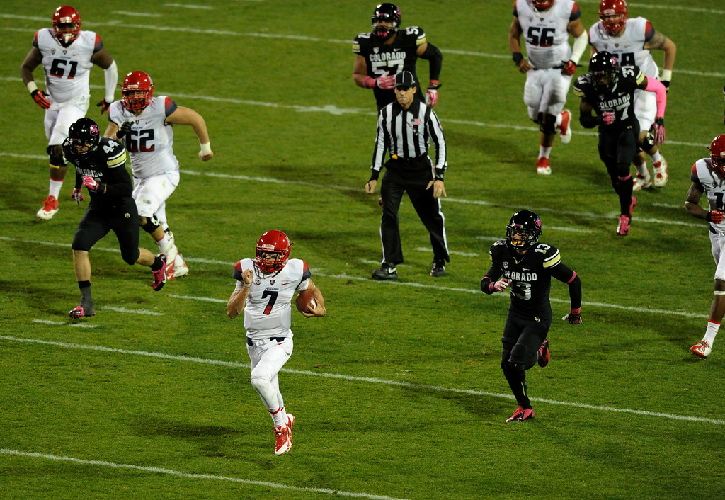 . BOULDER, CO. - OCTOBER 26: Arizona quarterback B.J. Denker (7) broke clear for a long gain early in the third quarter The University of Colorado football team hosted Arizona Saturday night, October 26, 2013. Photo By Karl Gehring/The Denver Post