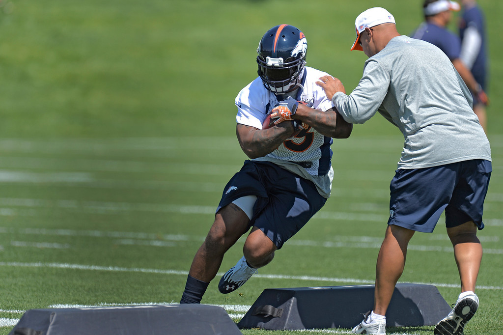 . Running back Willis McGahee (23) of the Denver Broncos runs through drills with Eric Studesville during mini camp June 11, 2013 at Dove Valley. (Photo By John Leyba/The Denver Post)